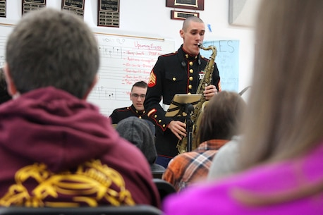 SAN DIEGO - Sgt. Tyler Van Dam, a saxophonist and a Moore Park, Calif., native, performs at Point Loma High School Jan. 27 in San Diego during a Marine Band San Diego jazz combo high school tour Jan. 26 through 30. The musical combo is touring high schools throughout Marne Corps Recruiting Station San Diego's area of operation and teaching students about Marine Corps musician enlistment opportunities. Each performance lasts approximately two hours and encompasses a variety of song styles including original pieces by the musicians. (U.S. Marine Corps photo by Sgt. Erica Kirsop/Released)