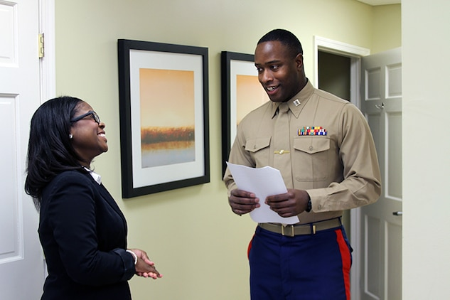 U.S Marine Corps Capt. Devin Claridy, the Officer Selection Officer for Officer Selection Station Norfolk and an Akron, Ohio native, explains the rules of a leadership exercise to Alyssa Lee, a sophomore studying mass communications at Virginia Union University, during the Marine Corps Leadership Seminar held at the Gloucester Institute in Virginia, Jan. 24, 2015. The seminar teaches Marine Corps leadership principles to college students in an effort to foster a positive image of the Marine Corps and to prepare the nation's future leaders by imparting values and lessons learned over the Corps' long and illustrious history. (U.S. Marine Corps photo by Sgt. Aaron Diamant/released)