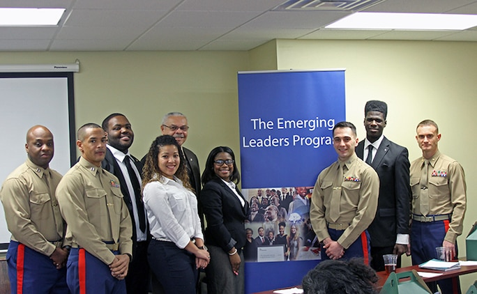 Members of the Gloucester Institutes Emerging Leaders Program pose with instructors and staff members of the Marine Corps Leadership Seminar and the guest speaker, retired Marine Corps Brig. Gen. George Walls, Jr., during the Marine Corps Leadership Seminar held at the Gloucester Institute in Virginia, Jan. 24, 2015. The seminar teaches Marine Corps leadership principles to college students, in an effort to foster a positive image of the Marine Corps and to prepare the nation's future leaders by imparting values and lessons learned over the Corps' long and illustrious history. (U.S. Marine Corps photo by Sgt. Aaron Diamant/released)