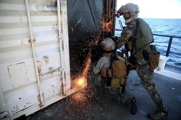 Critical Skills Operators with Bravo Company, 1st Marine Special Operations Battalion, U.S. Marine Corps Forces, Special Operations Command, saw through a steel door during Visit, Board, Search and Seizure training near Naval Base Coronado, Calif., Jan. 15. (Official Marine Corps photo by Sgt. Donovan Lee/released)