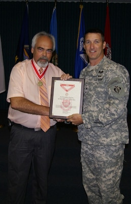 Eugene Goff, the Kansas Area Manager for the Tulsa District U.S. Army Corps of Engineers receives the coveted de Fleury Medal from Col. Richard A. Pratt, commander, Tulsa District.