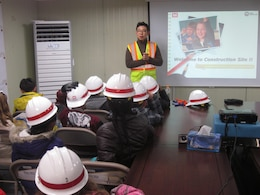 U.S. Army Corps of Engineers Central resident office project engineer James Lee provides students of Osan American Elementary School a brief video presentation and overview of the construction site of their future school.