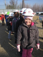 Osan American Elementary student Bianca Torelli and her classmates visit the future site of their new school Jan. 20 as part of a tour given by the U.S. Army Corps of Engineers Far East District central resident office.