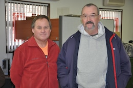Bob Lamoreaux (left) and Jerry Giefer pose for a picture inside the operations office on the Far East District compound Jan. 23. Lamoreaux provided life saving cardio-pulmonary resuscitation after Giefer suffered a heart attack Dec. 30.
