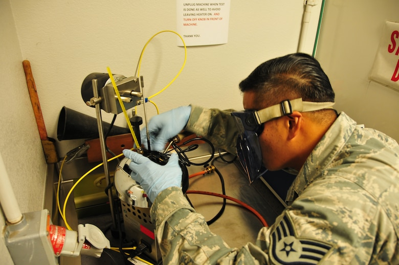 Staff Sgt. Benedict Barroga, 161st Logistics Readiness Squadron fuels technician, analyses fuel as part of a fuel quality control test, 161st Air Refueling Wing, Phoenix, Jan. 29, 2015. This test ensures fuel additives are present and in the specified quantities. The fuel is tested when the base initially received it, as well as twice a month, to ensure that the fuel received here meets the highest standards required by the U.S. Air Force. (U.S. Air National Guard photo by Tech. Sgt. Michael Matkin/Released)