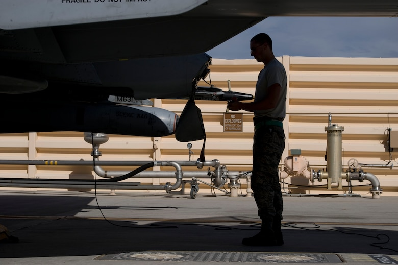 Senior Airman Charles Nicholls, a crew chief assigned to the 355th Aircraft Maintenance Squadron, Davis-Monthan Air Force Base, Ariz., performs pre-flight inspections on an A-10 Thunderbolt II during Green Flag-West 15-03 at Nellis Air Force Base, Nev., Jan. 26, 2015. The A-10 has excellent maneuverability at low air speeds and altitude, and is a highly accurate and survivable weapons-delivery platform. (U.S. Air Force photo by Airman 1st Class Mikaley Towle)