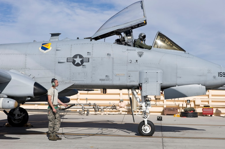 Senior Airman Charles Nicholls, a crew chief assigned to the 355th Aircraft Maintenance Squadron, Davis-Monthan Air Force Base, Ariz., performs pre-flight inspections on an A-10 Thunderbolt II during Green Flag-West 15-03 at Nellis Air Force Base, Nev., Jan. 26, 2015. Specifically designed for close air support, its combination of large and varied ordnance load, long loiter time, accurate weapons delivery, austere field capability, and survivability has proven invaluable to the United States and its allies. (U.S. Air Force photo by Airman 1st Class Mikaley Towle)