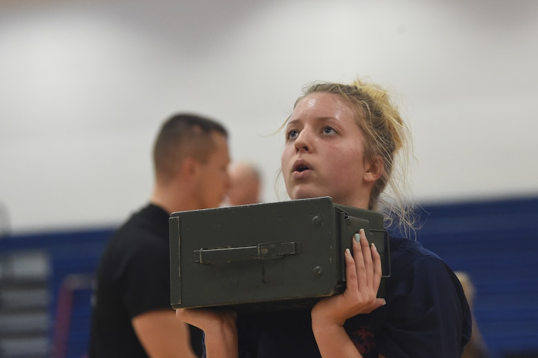 A U.S. Marine Corps poolee lifts an ammunition can during a delayed entry program all-female workout held Jan. 17, 2015, at the fitness center on Buckley Air Force Base, Colo. Poolees are members of the DEP that have not yet shipped out to recruit training. The DEP workouts consist of strengthening exercises such as pull-ups, box jumps, push-ups and squats to enable the poolees to be accustomed to the vigorous workouts and stress they will endure during recruit training. (U.S. Air Force photo by Airman 1st Class Samantha Saulsbury/Released)