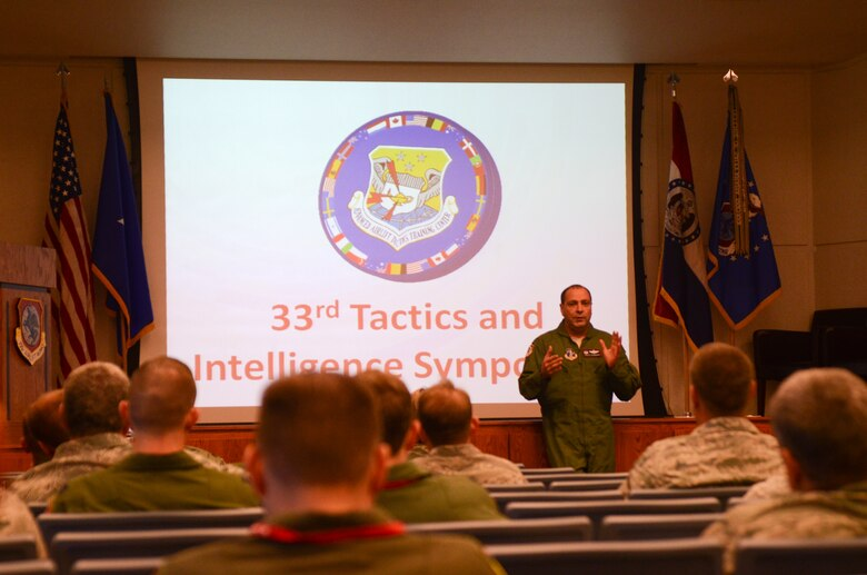 U.S. Air Force Col. Ralph Schwader, commander of the 139th Airlift Wing, Missouri Air National Guard, speaks during 33rd Annual Tactics and Intelligence Symposium Jan. 27, 2015 at Rosecrans Air National Guard Base, Mo. The Advanced Airlift Tactics Training Center hosts the symposium and the theme this year is international innovation and integration in mobility air forces. (U.S. Air National Guard photo by Tech. Sgt. Michael Crane/Released)