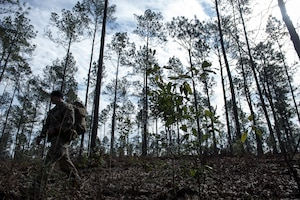 Tech. Sgt. John Conant IV, a 34th Combat Training Squadron SERE specialist, evaluates a Dyess Air Force Base, Texas, aircrew as they evade through the woods during Green Flag Little Rock Jan. 15, 2015, at Fort Polk, La. The crew were only equipped with their survival vests and Conant's coaching. (U.S. Air Force photo/Senior Airman Cliffton Dolezal)