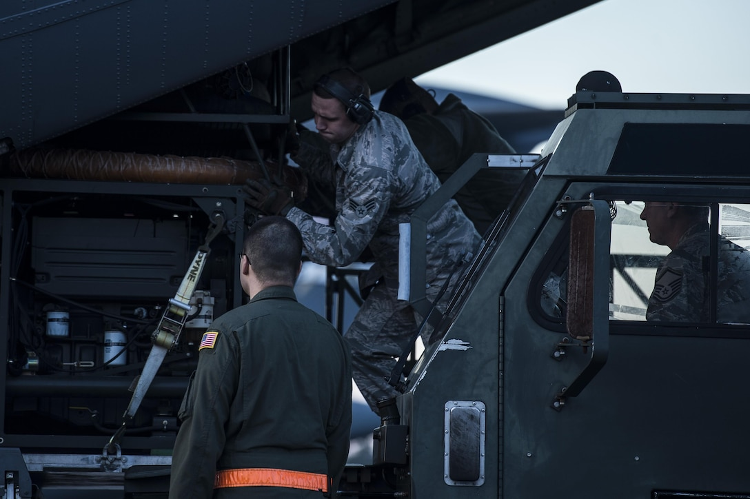 Airmen load an aerial bulk fuel delivery system (ABFDS) onto a C-130J Super Hercules Jan. 16, 2015, at Little Rock Air Force Base, Ark. The ABFDS is used to jump fuel in or out of a fuel bladder. The Airmen are assigned to the 19th Logistics Readiness Squadron. (U.S. Air Force photo/Senior Airman Cliffton Dolezal)