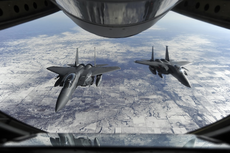 Two F-15E Strike Eagles wait to receive fuel from a KC-135R Stratotanker Jan. 23, 2015, on their way to Nellis Air Force Base, Nev., in support of Red Flag 15-1. The exercise, featuring aircraft from 21 different Air Force squadrons, offers realistic combat training involving the air, space and cyber forces of the U.S. and its allies. The F-15s are assigned to the 4th Fighter Wing and the KC-135R is assigned to the 916th Air Refueling Wing. (U.S. Air Force photo/Airman 1st Class Aaron J. Jenne)