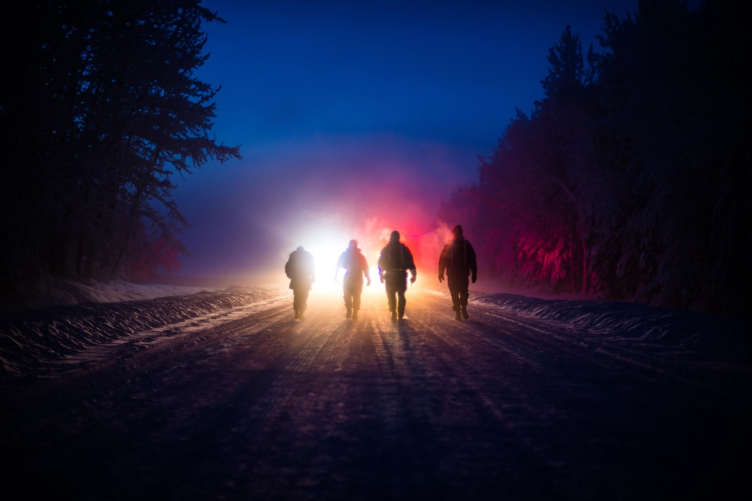 Members of the 354th Fighter Wing inspection team walk toward first responders Jan. 26, 2015, during a major accident response exercise (MARE) at Eielson Air Force Base, Alaska. The MARE tested first responders' skills in a controlled environment to give Icemen confidence in handling the event in a real-world situation. (U.S. Air Force photo/Staff Sgt. Joshua Turner)
