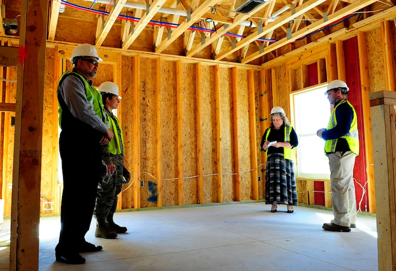 Construction leaders give a tour of a house in the Osprey Landing neighborhood at Hurlburt Field, Fla., Jan. 28, 2015. After the wiring is finished, insulation, carpeting and amenities will be installed. (U. S. Air Force photo/Airman 1st Class Andrea Posey)