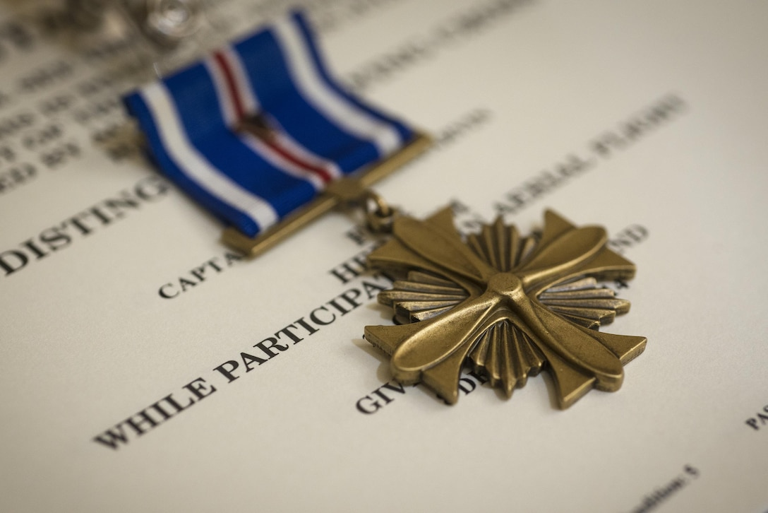 A Distinguished Flying Cross sits on display prior to being awarded to Maj. Jeremiah Parvin Jan. 29, 2015, at Moody Air Force Base, Ga. The DFC is awarded for heroism or extraordinary achievement while participating in an aerial flight. Parvin is a 75th Fighter Squadron A-10C Thunderbolt II pilot. (U.S. Air Force photo/Senior Airman Ryan Callaghan)