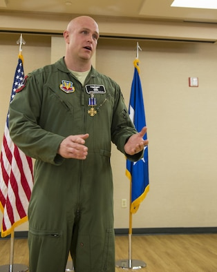 Maj. Jeremiah Parvin gives a speech during his Distinguished Flying Cross with Valor ceremony Jan. 29, 2015, at Moody Air Force Base, Ga. Maj. Gen. H. D. Polumbo Jr., the Ninth Air Force commander, presided over the ceremony and presented Parvin with the medal. Parvin is the 75th Fighter Squadron director of operations. (U.S. Air Force photo/Airman 1st Class Ceaira Tinsley)