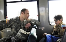 Maj. Jason Allen, U.S. Army Corps of Engineers, Baltimore District, chats with a Cub Scout between various stops made during a tour of Poplar Island.