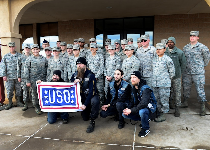 U.S. Air Force Air Commandos with the 27th Special Operations Wing gather for a group photo after breakfast with the Black Label Society outside the Pecos Trail Dining Facility Jan. 28, 2015 at Cannon Air Force Base, N.M. The band was afforded an opportunity to dine with recent award winners from around the wing before their tour of the installation. (U.S. Air Force photo/Airman 1st Class Shelby Kay-Fantozzi)