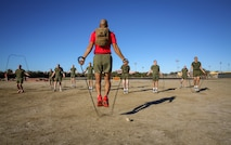 Staff Sgt. Jose A. Pinel, drill instructor, Delta Company, 1st Recruit Training Battalion, performs jump rope exercises with recruits during interval training at Marine Corps Recruit Depot San Diego, Jan. 15.  The Marine Corps uses interval training to help recruits gain physical endurance and to prepare them for upcoming challenges.