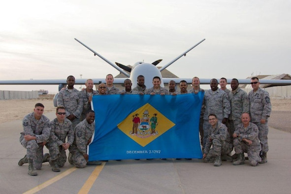Airmen of the166th Civil Engineer Squadron, 166th Airlift Wing, Delaware Air National Guard, pose while deployed to an undisclosed location in Southwest Asia on Jan. 5, 2015. Kneeling, L to R: Tech. Sgt. Joe Sparacio, Tech. Sgt. Sean Cline, Master Sgt. Maurice Williams, Staff Sgt. Bob Natale, Tech. Sgt. Mike Lawson. Standing, L to R: Senior Airman Brent Green, Master Sgt. Mike Caldwell, Senior Airman Kirk Phang, Master Sgt. Greg Lichtner, Senior Airman James Barnes, Staff Sgt. Kenrick Gray, Senior Airman Jeremy Burgos, Senior Airman Durrelle Petty, Senior Airman Joe Gilford, Staff Sgt. Andy Steward, Tech. Sgt. Hilton William, Staff Sgt. Shawn Moore, Senior Airman Josh Robbins, Chief Master Sgt. Lorne Peterson (U.S. Air National Guard courtesy photo)