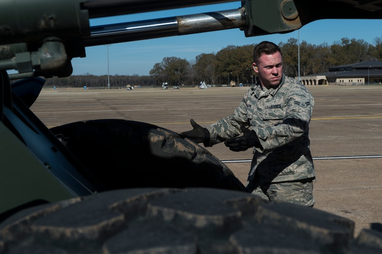 A member of the 571st Contingency Response Group stationed at Travis Air Force Base, Calif., trains during an exercise at the Joint Readiness Training Center at Fort Polk, La., Jan. 19, 2015. JRTC is a 34th Combat Training Squadron exercise for the U.S. Army that improves unit readiness by providing realistic, stressful, joint and combined arms training across the full spectrum of conflict. The Airmen helped support the exercise, and also provided an opportunity for internal training. (U.S. Air Force photo/Staff Sgt. Gustavo Gonzalez/RELEASED)