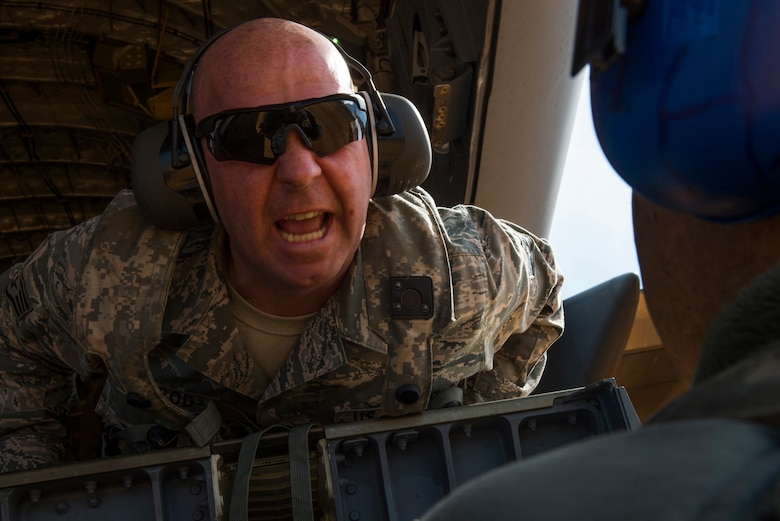 Staff Sgt. Thomas Sherrod, 817th Contingency Response Group aerial porter stationed at Joint Base McGuire-Dix-Lakehurst, N.J., speaks to an Airmen during a  training exercise at the Joint Readiness Training Center at Fort Polk, La., Jan. 17, 2015. JRTC is a 34th Combat Training Squadron exercise for the U.S. Army that improves unit readiness by providing realistic, stressful, joint and combined arms training across the full spectrum of conflict. The Airmen helped support the exercise, and also provided an opportunity for internal training. (U.S. Air Force photo/Staff Sgt. Gustavo Gonzalez/RELEASED)