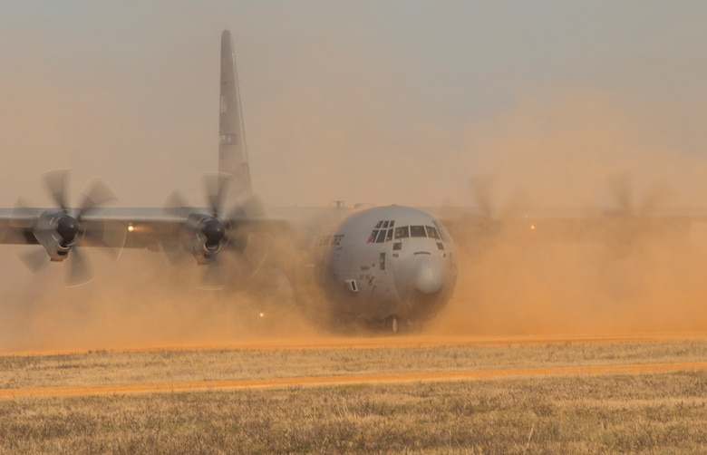 A U.S. Air Force C-130 Hercules lands during a training exercise at the Joint Readiness Training Center at Fort. Polk, La., Jan. 17, 2015. JRTC is a 34th Combat Training Squadron exercise for the U.S. Army that improves unit readiness by providing realistic, stressful, joint and combined arms training across the full spectrum of conflict. The Airmen helped support the exercise, and also provided an opportunity for internal training. (U.S. Air Force photo/Staff Sgt. Gustavo Gonzalez/RELEASED)