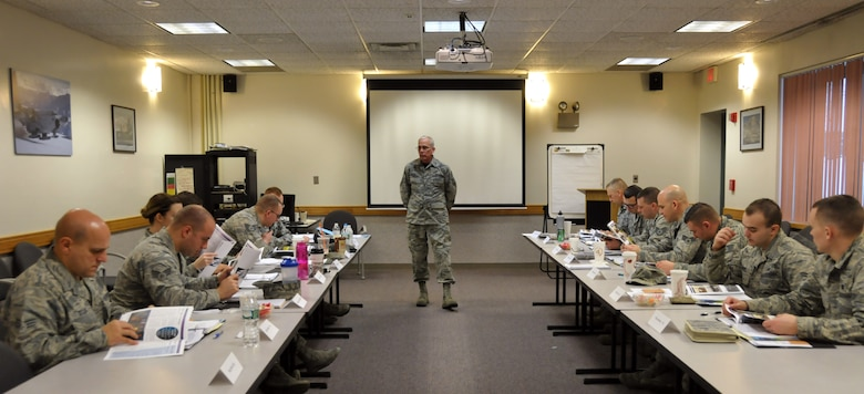 Chief Master Sgt. Mark Schaible talks about the 109th Airlift Wing's history during the wing's first Airman Development Course at Stratton Air National Guard Base, N.Y., on  Jan. 30, 2015. 14 Airmen throughout the base took the three-day course Jan. 28-30, 2015. Along with the wing's history, the course covered topics on public speaking, Air Force heritage, teambuilding, conflict resolution, the evaluation process, financial and educational benefits, and more. (U.S. Air National Guard photo by Tech. Sgt. Catharine Schmidt/Released)