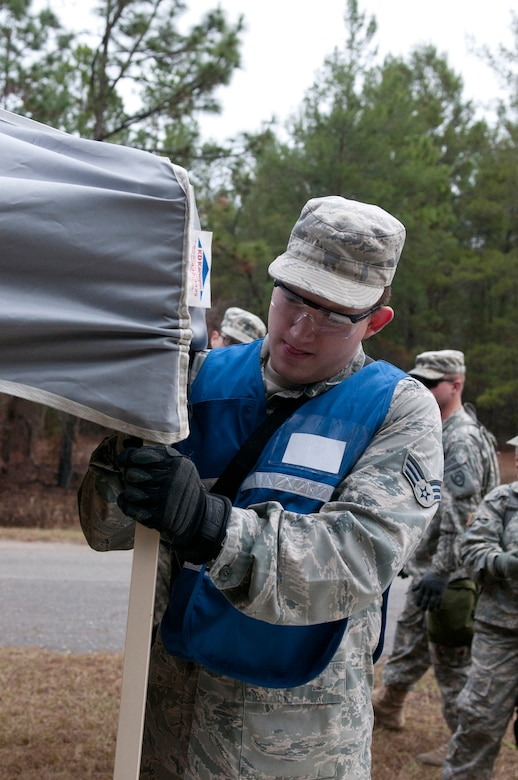 Air Force Senior Airman Jacob Blevins, a member of the Kentucky National Guard CERFP hot zone triage team, assembles a medical tent during Operation Starke Thunder at Camp Blanding in Starke, Fla., Jan. 12, 2015. The four-day exercise certified the joint Kentucky Army and Air Guard emergency-response team as mission-ready. (U.S. Air National Guard photo by Staff Sgt. Vicky Spesard)