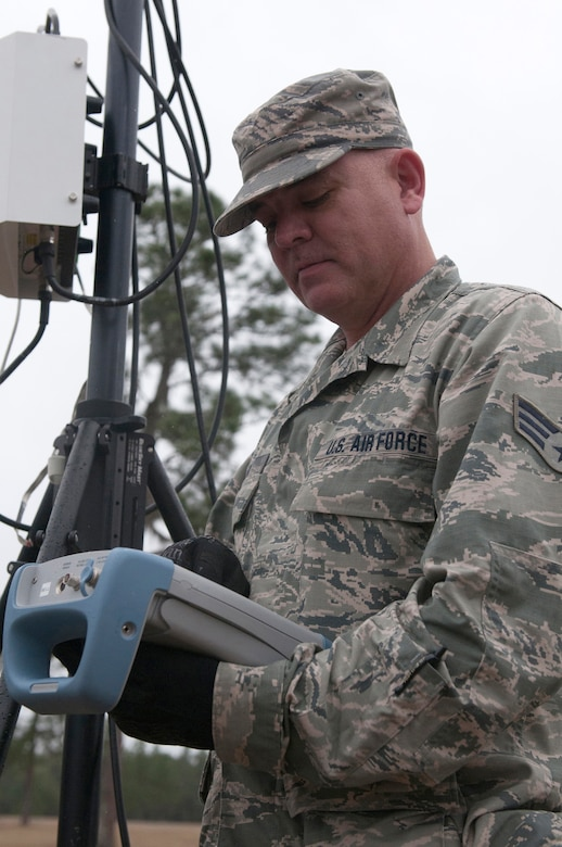 Air Force Senior Airman Eric Clark from the Kentucky National Guard CERFP uses Joint Incident Site Communications Capability to provide wireless communications during Operation Starke Thunder at Camp Blanding in Starke, Fla., Jan. 13, 2015. The four-day exercise certified the joint Kentucky Army and Air Guard emergency-response team as mission-ready. (U.S. Air National Guard photo by Staff Sgt. Vicky Spesard)