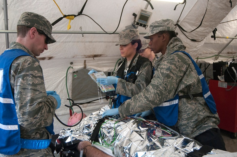Airmen from the Kentucky National Guard CERFP's medical element evaluate the simulated injuries of a patient during Operation Starke Thunder at Camp Blanding in Starke, Fla., Jan. 13, 2015. The four-day exercise certified the joint Kentucky Army and Air Guard emergency-response team as mission-ready. (U.S. Air National Guard photo by Staff Sgt. Vicky Spesard)