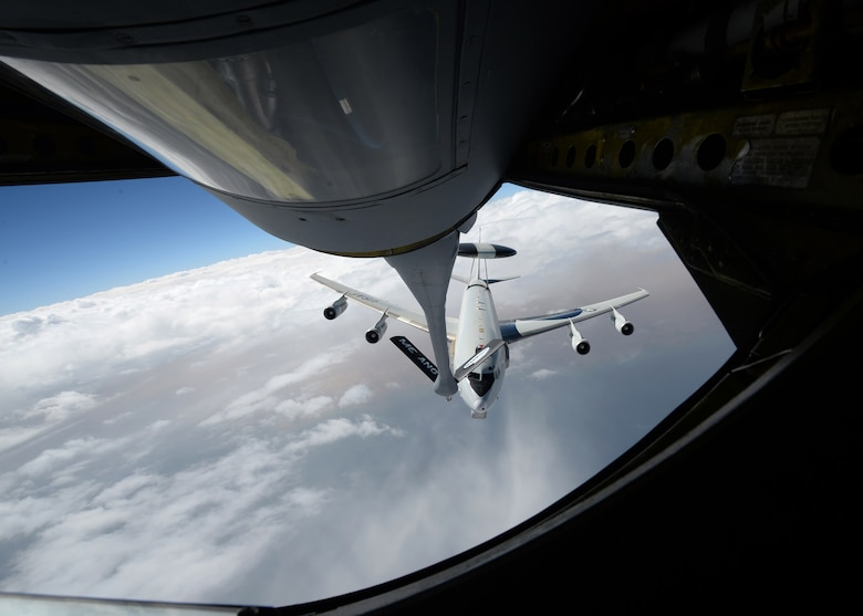 """A U.S. Air Force E-3 """"Sentry"""" Airborne Warning and Control System aircraft from Tinker Air Force Base approaches a KC-135 """"Stratotanker"""" from the Maine Air National Guard during refueling operations over Iraq on Oct. 2, in support of operations against ISIL/ISIS targets. The AWACS provides situational awareness of friendly, neutral and hostile activity, command and control of an area of responsibility, battle management of theater forces, all-altitude and all-weather surveillance of the battle space, and early warning of enemy actions during joint, allied and coalition operations. (Air Force photo by Staff Sgt. Shawn Nickel)"""