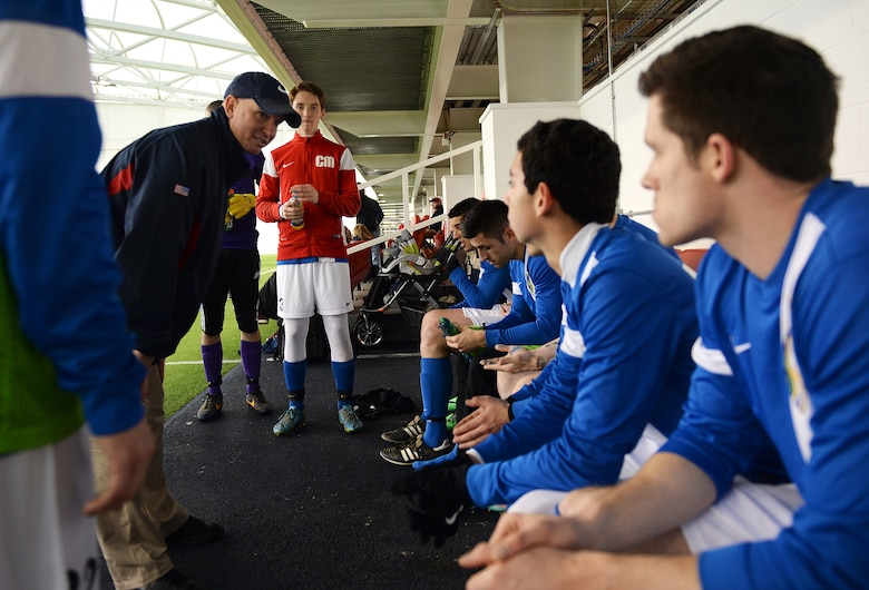 Lt. Col. Derrick Weyand, head coach for the Liberty Football Club, discusses strategies for the second half of the game during a match against the world-ranked England Cerebral Palsy team at St. George's Park, England, Jan. 25, 2015. Active duty members, dependents and high school students are welcome to join the Liberty Football Club. (U.S. Air Force photo by Staff Sgt. Emerson Nuñez/Released)