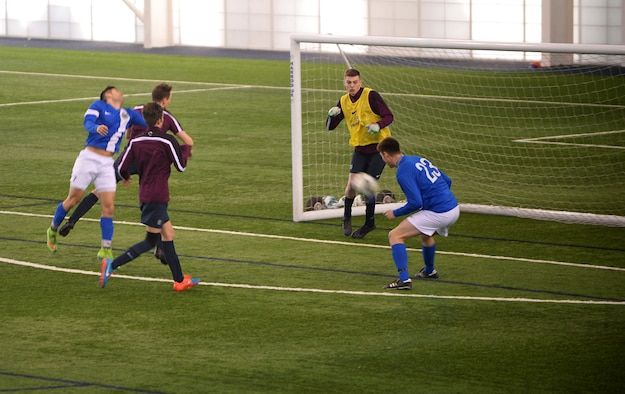 Maj. Doug Grabowski, a forward for the Liberty Football Club, attempts to score during a match against the world-ranked England Cerebral Palsy team at St. George's Park, England, Jan. 25, 2015. Active duty members, dependents and high school students are welcome to join the Liberty Football Club. (U.S. Air Force photo by Staff Sgt. Emerson Nuñez/Released)