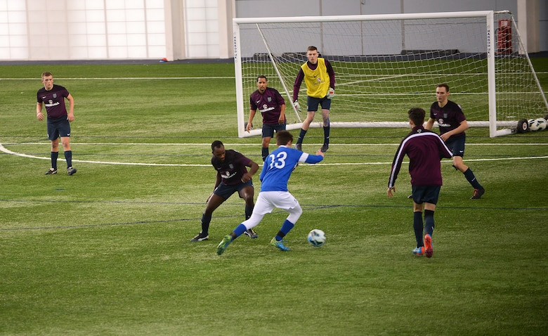 Christopher Miles, a midfielder for the Liberty Football Club, advances past defenders during a match against the world-ranked England Cerebral Palsy team at St. George's Park, England, Jan. 25, 2015. The England CP team is currently training for the 2015 CP World Cup, which will be hosted by England at St. George's Park. (U.S. Air Force photo by Staff Sgt. Emerson Nuñez/Released)