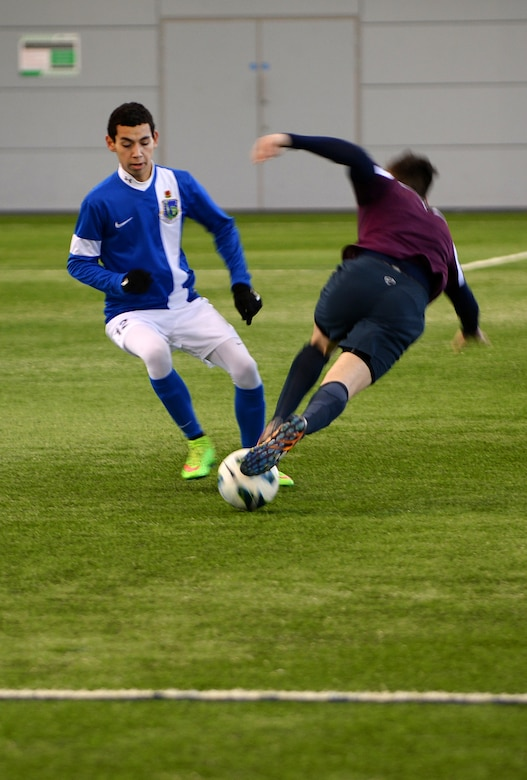 Kyle Freaney, a forward for the Liberty Football Club, takes control of the ball during a match against the world-ranked England Cerebral Palsy team at St. George's Park, England, Jan. 25, 2015. The England CP team is currently training for the 2015 CP World Cup, which will be hosted by England at St. George's Park. (U.S. Air Force photo by Staff Sgt. Emerson Nuñez/Released)