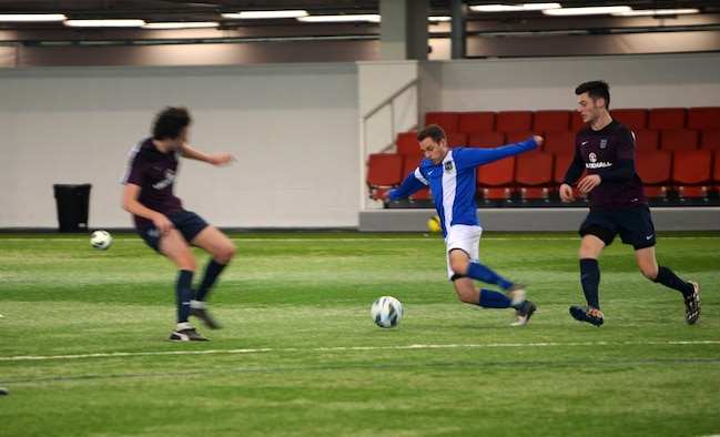 Airman 1st Class Justin Howard, a defender for the Liberty Football Club, prepares to pass the ball to a teammate during a match against the world-ranked England Cerebral Palsy team at St. George's Park, England, Jan. 25, 2015. This match highlighted the continued cooperation and relationship between the U.K. and the U.S. (U.S. Air Force photo by Staff Sgt. Emerson Nuñez/Released)