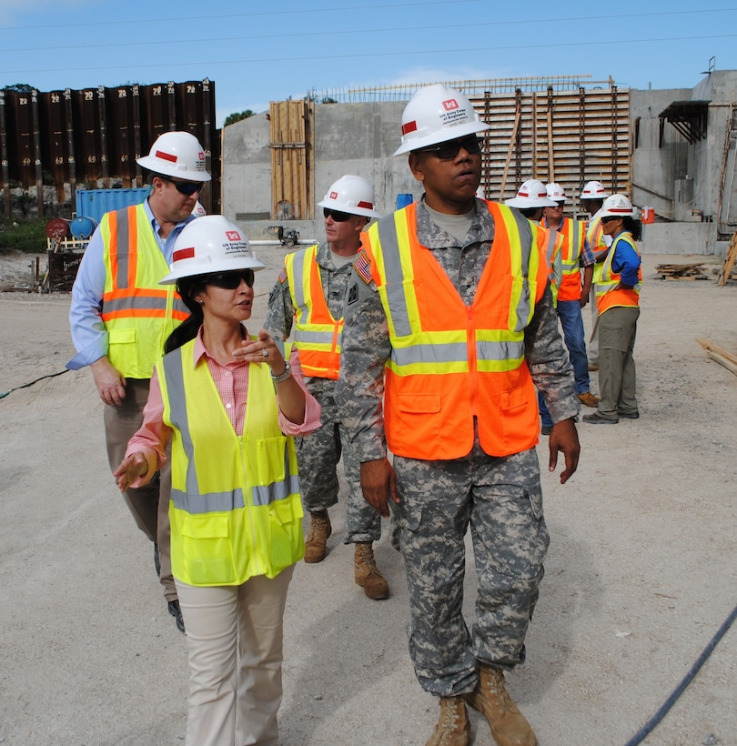 Eva Porras (left), Construction Engineer with the U.S. Army Corps of Engineers (USACE) Herbert Hoover Dike Resident Office, shows USACE South Atlantic Division Commander Brig. Gen. David Turner (right) some key features of a culvert replacement project near Canal Point, Fla. USACE is working to replace 26 culverts which are seen as posing the biggest risk to the integrity of the dike; 16 of those culverts are currently under contract, with contract awards on the remaining 10 expected over the next four years.