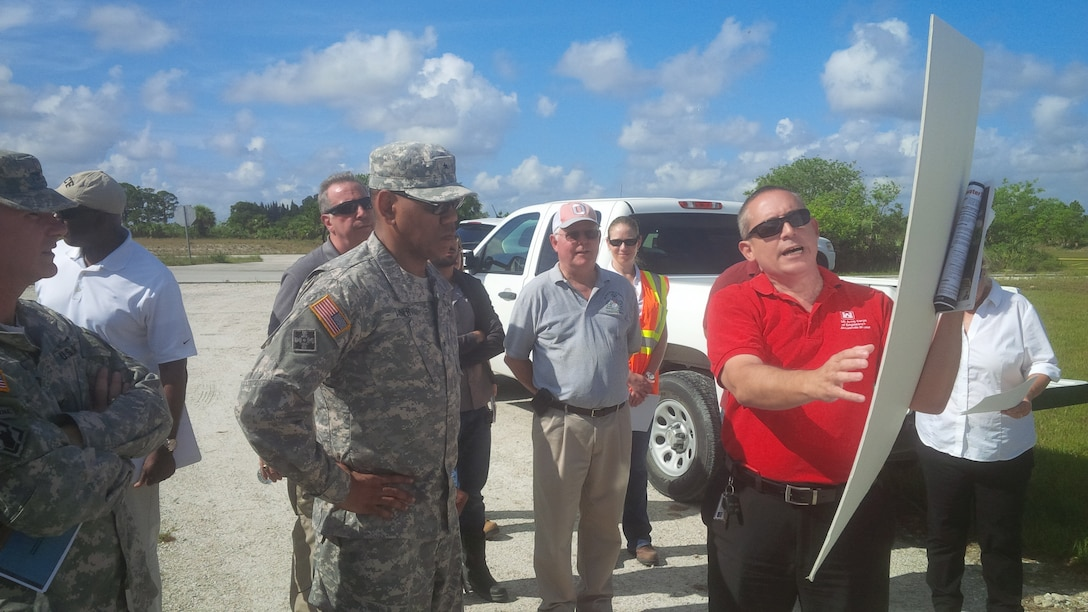 Orlando Ramos-Gines (right), project manager for the U.S. Army Corps of Engineers Jacksonville District, briefs the commander of the Corps' South Atlantic Division, Brig. Gen. David Turner, on construction progress at the C-44 Reservoir and Stormwater Treatment Area Project near Indiantown, Fla.  The briefing was part of a tour conducted June 23-24 where the general viewed ecosystem restoration and flood risk reduction projects in south Florida.