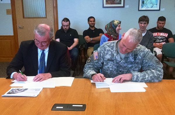 Col. Christopher Barron, New England District Commander, entered into an education partnership agreement with MassBay Community College, May 26, 2015.  Col. Barron and John O'Donnell, President of MassBay Community College signed the agreement at the Wellesley, Massachusetts Campus.
