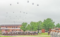 OH-58 Kiowa Warrior helicopters fly over a formation of Soldiers from the 1st Infantry Division as Soldiers prepare to participate in a division run June 12 at Custer Hill at Fort Riley. The flight was conducted by aviators from the 1st Sqdn., 6th Cav. Regt., 1st CAB, 1st Inf. Div., and it was the final formation flight over the Fort Riley area. The flight was performed in conjunction with Fort Riley's 2015 Victory Week.