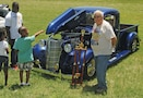 It was the strong of heart who braved the oppressive heat and made the Fort Riley Car Show at McCormick Park a success on June 20.  When it was all said and done, two entrants took home Best in Show honors.  Best in Show for model cars 1979 or older was a 1938 Chevy Pick-up owned by Victor Enns, a retired civilian from Manhattan.