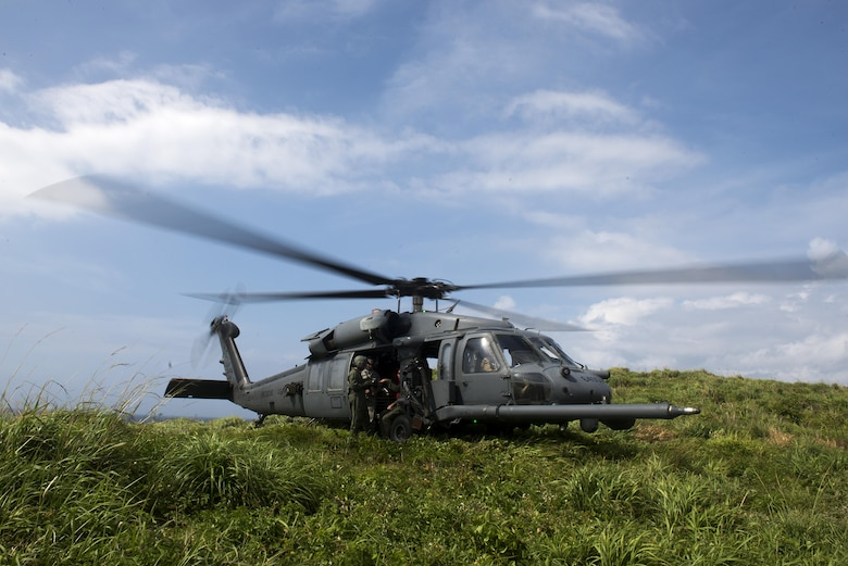 A U.S. Air Force HH-60G Pave Hawk helicopter from the 33rd Rescue Squadron lands on a small island off the coast of Okinawa, Japan, during a large force exercise June 30, 2015. During the exercise, U.S. Air Force flying squadrons from Kadena Air Base, Japan, partnered with Vermont Air National Guard F-16 Vipers and U.S. Marine Corps units from Marine Corps Air Station on Okinawa in order to improve interservice interoperability in the region. (U.S. Air Force photo by Staff Sgt. Maeson L. Elleman/Released)