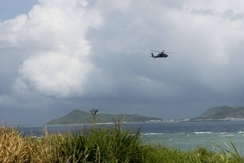 A U.S. Air Force HH-60G Pave Hawk helicopter from the 33rd Rescue Squadron flies off the coast of Okinawa, Japan, during a large force exercise June 30, 2015. The exercise, which integrated U.S. Air Force and Marine Corps assets on Okinawa, was designed to allow the units to practice air-to-air capabilities while supporting ground troops. (U.S. Air Force photo by Staff Sgt. Maeson L. Elleman/Released)