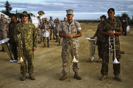Musicians from the U.S. Marine Corps Forces, Pacific band, the Tonga Royal Corps of Musicians, and the Australian Army, pose together in Nuku'alofa, Tonga, July 1, 2015. The MARFORPAC Band travels throughout the Pacific region to promote community relations and interoperability between the U.S. and other countries.