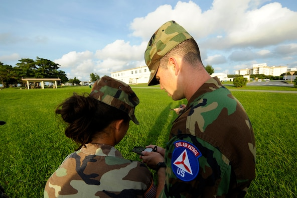 U.S. Air Force Senior Airman Chance Sheek, 18th Logistics Readiness Squadron vehicle operator, teaches a young cadet in the Civil Air Patrol how to use a compass on Kadena Air Base, Japan, June 26, 2015. Sheek is now a first lieutenant in the Civil Air Patrol and is held responsible for ground emergency training such as search and rescues. (U.S. Air Force photo by Airman 1st Class Zackary A. Henry)