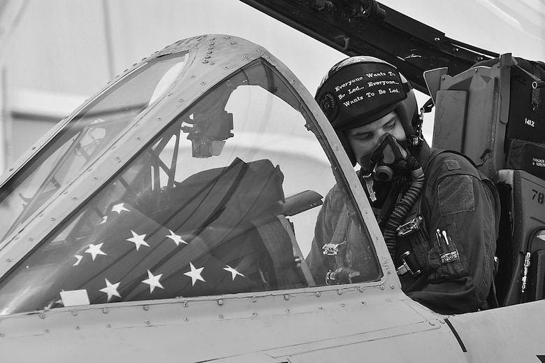 "U.S. Air Force Maj. Timothy Grebs, 357th Fighter Squadron former instructor pilot, opens the cockpit after his final flight in the A-10 at Davis-Monthan Air Force Base, Ariz., June 26, 2015. While stationed at D-M, Grebs served as the 355th Force Support Squadron commander, an A-10 instructor pilot, and 355th Fighter Wing executive. During his final flight before retiring from the Air Force, Grebs donned a visor cover which read ""Everyone Wants to Be Led."" (U.S. Air Force illustration by Airman 1st Class Chris Drzazgowski/Released)"