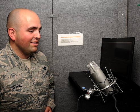 Airman 1st Class Ryan Sparks, 319th Air Base Wing Public Affairs photojournalist, practices singing the national anthem in the PA studio booth on Grand Forks Air Force Base, N.D. on July 1, 2015. Sparks was named warrior of the week for the first week of July. (U.S. Air Force Photo by Senior Airman Zachiah Roberson/released)
