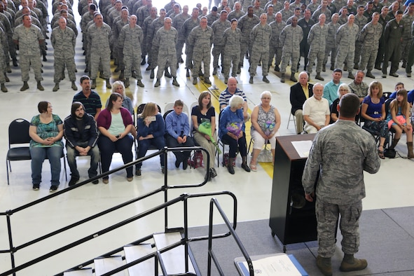 Members of the 179th Airlift Wing gather for the Command Chief Change of Command Ceremony in Mansfield, OH, May 16, 2015. Command Chief Master Sgt. Thomas A. Jones takes the position as Thomas A. Gremling retires after 35 years of service to the 179th Airlift Wing.(U.S. Air National Guard Photo by Tech. Sgt. Joe Harwood\Released)