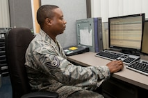 Tech. Sgt. Sakima McCordy checks the results of a software test June 26 at Scott Air Force Base, Illinois. McCordy checks software test results weekly. McCordy is the 375th Communications Support Squadron Air Mobility Command Information Assurance NCOIC. (U.S. Air Force Photo by Airman 1st Class Megan Friedl)